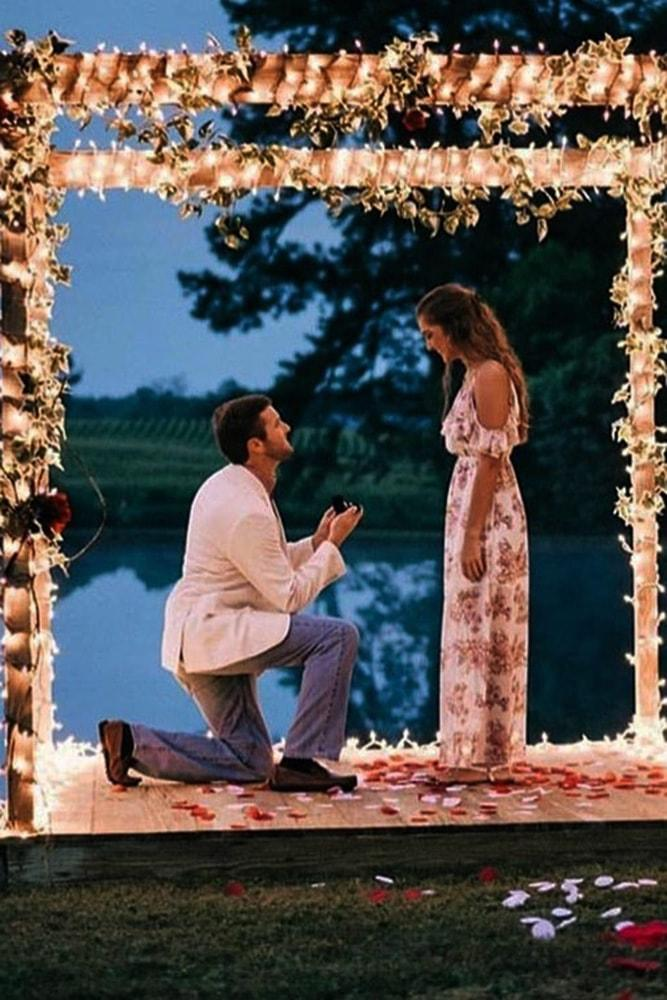best proposal ideas fairy tale night time proposal ideas with flowers and lights on arbor near lake