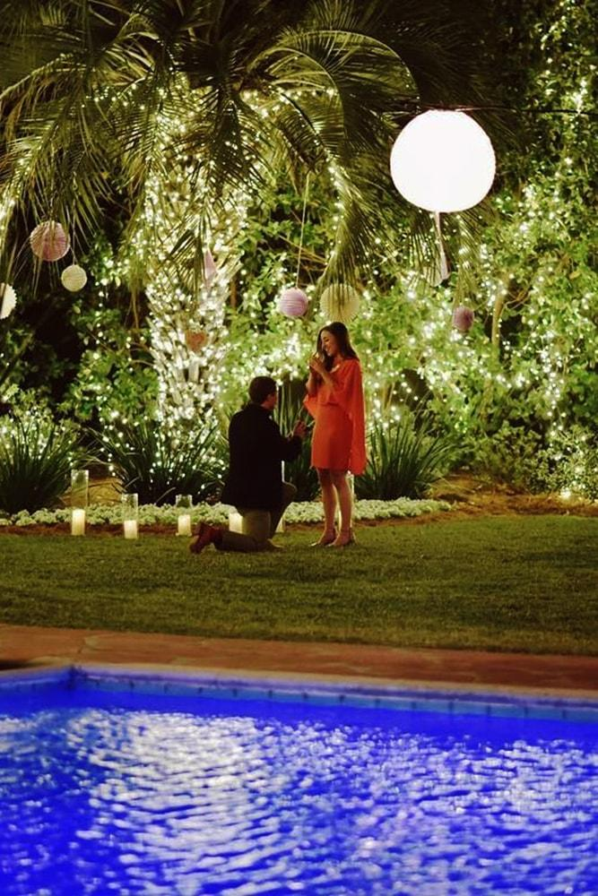 best proposal ideas fairy tale night time proposal ideas with lights on palm trees near pool