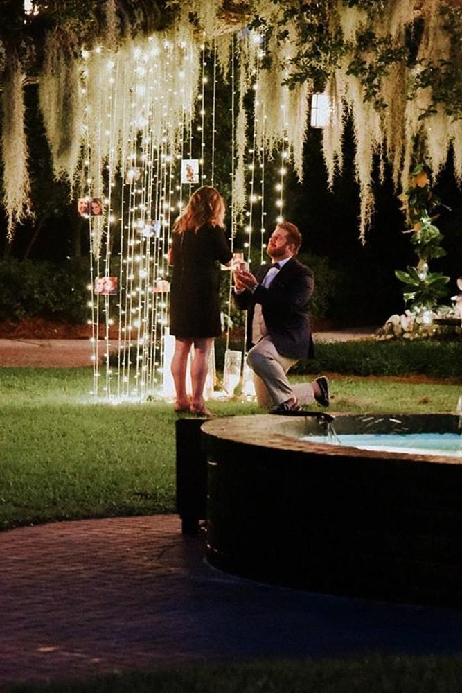 best proposal ideas fairy tale night time proposal ideas with lights on trees near fountain