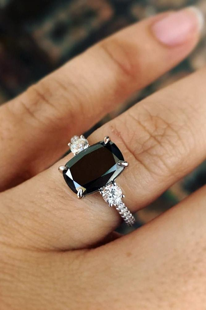 black diamond engagement rings white gold three stone ring black diamond in centre two round cut white diamonds on the sides pave band
