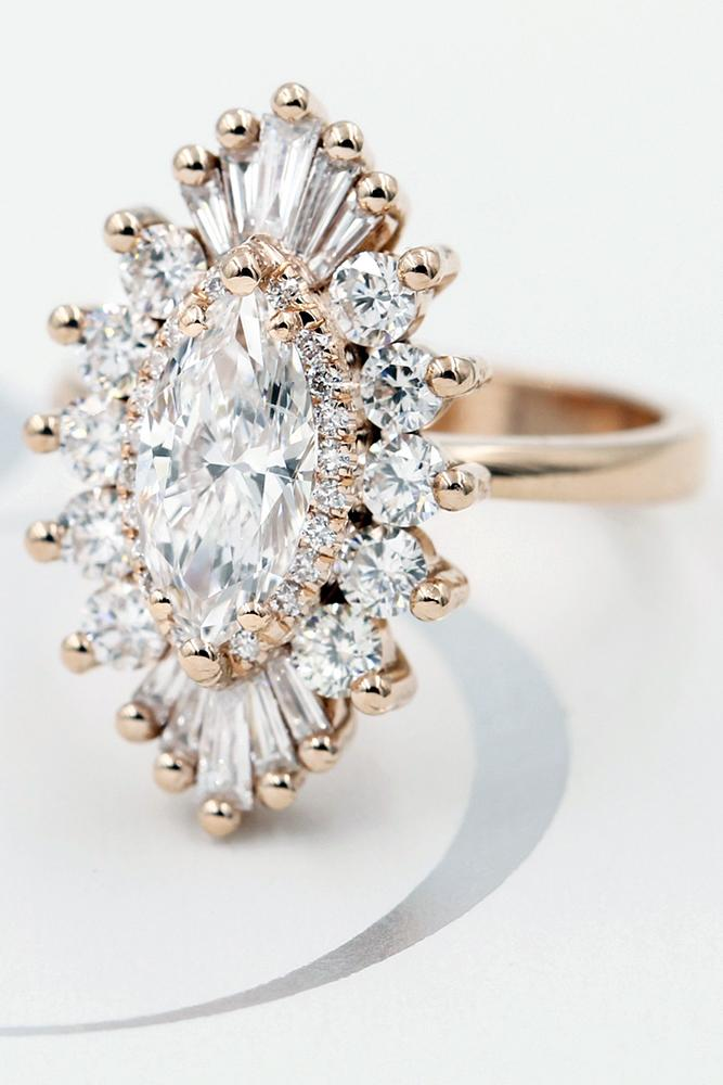 diamond halo ovalcut diamond in beautiful brilliant halo in a floral style