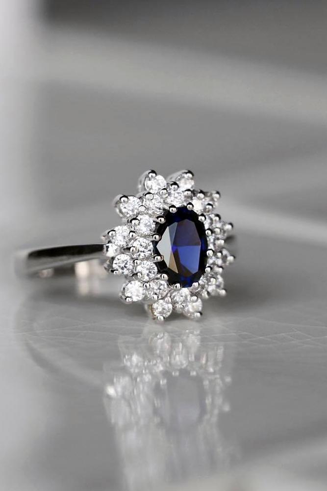 diamond halo ovalcut sapphire stone in floral brilliant halo