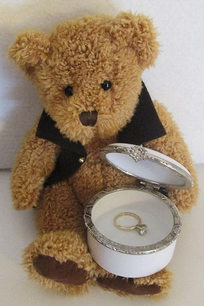 engagement photos teddy bear yellow gold ring simple solitaire diamoind
