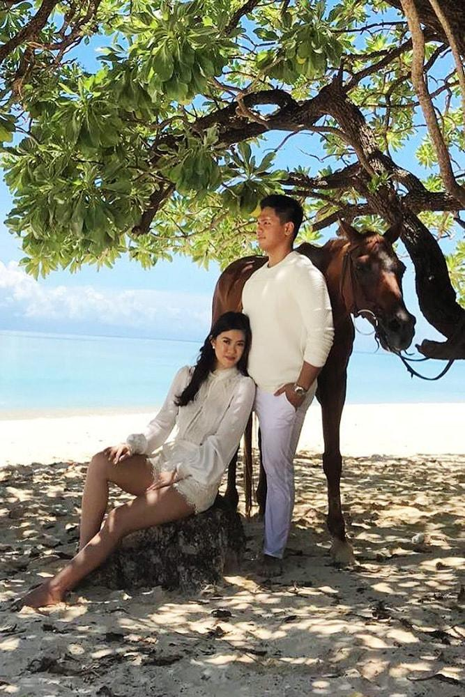 engagement pictures cute photo on the beach with a horse