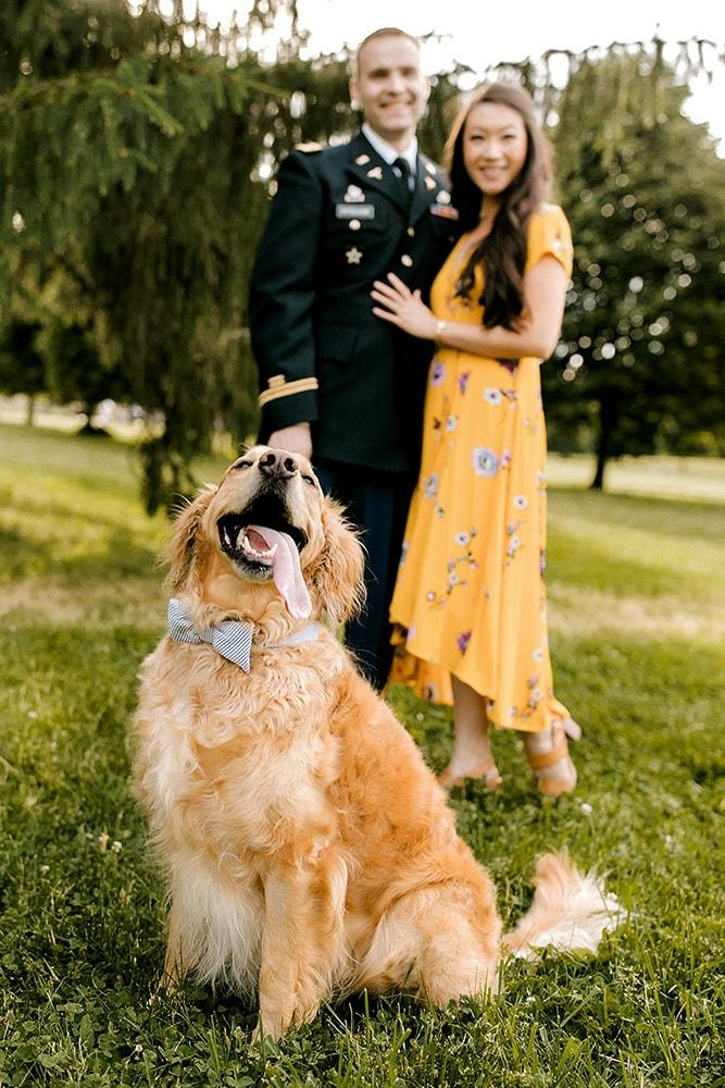engagement pictures with a dog in the park engagement photo
