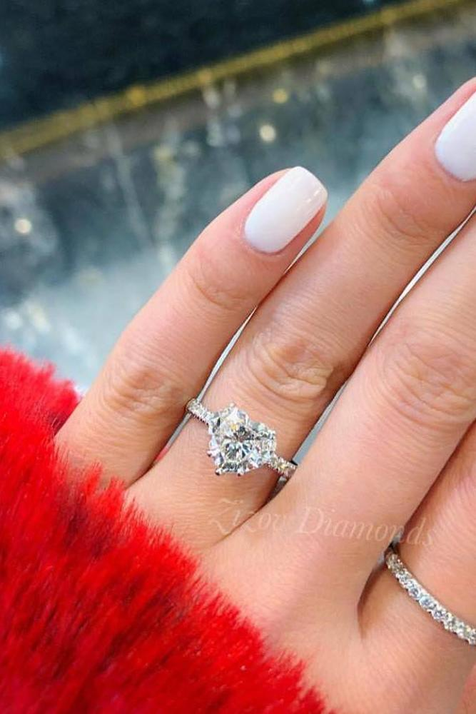 engagement ring shapes heart cut diamond ring on a hand in a red fur