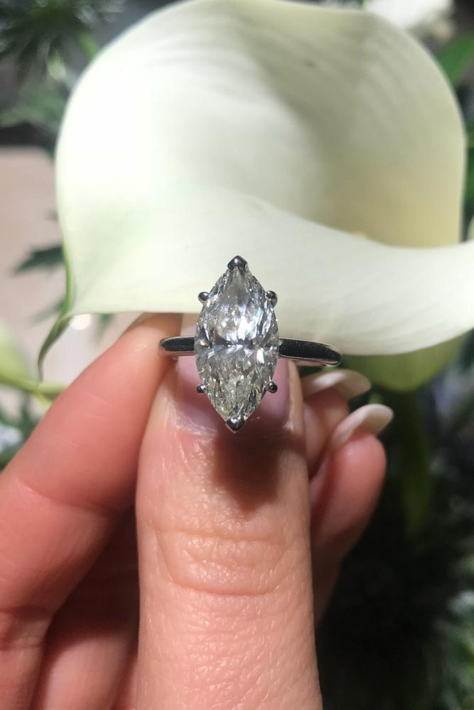 engagement ring shapes marquise cut diamond stone in platinum band in simple style