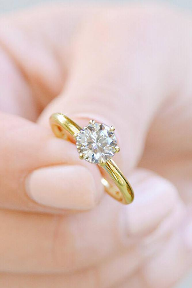 engagement ring shapes one roundcut diamond in a simple style with yellow gold band