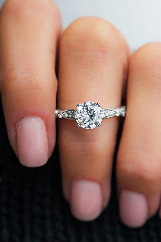 white gold engagement ring round cut diamond solitaire pave band unique details