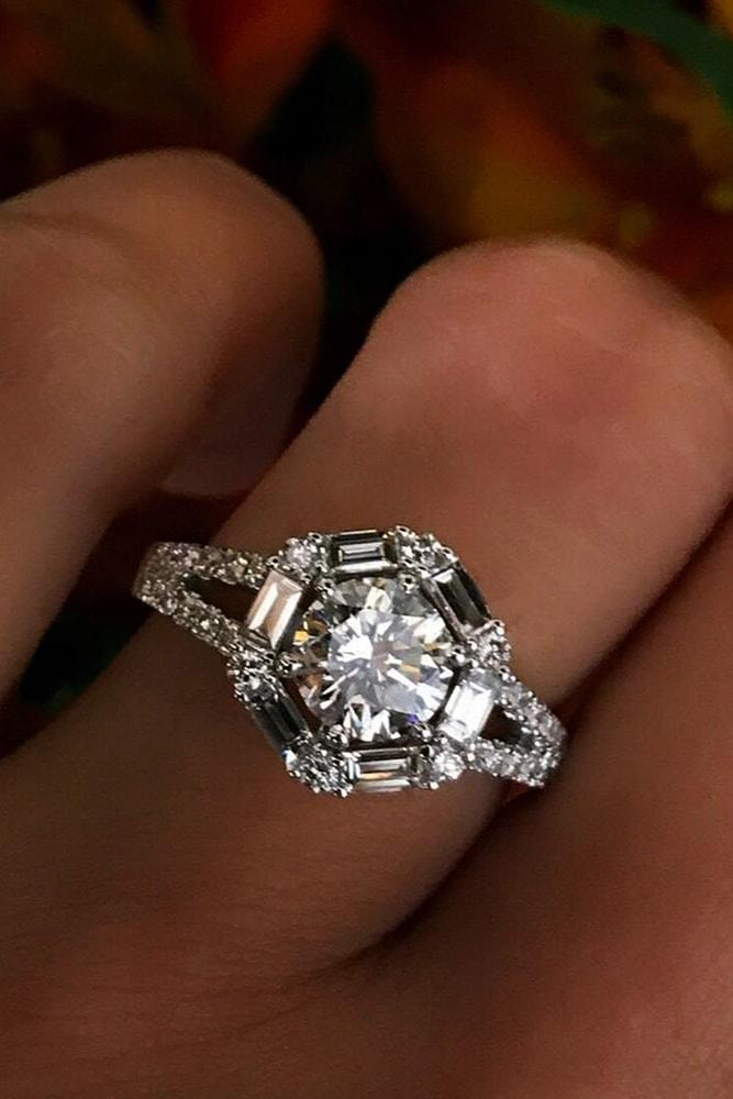 white gold engagement rings modern ring round cut diamond in centre halo with emerald cut and round cut diamonds split shank