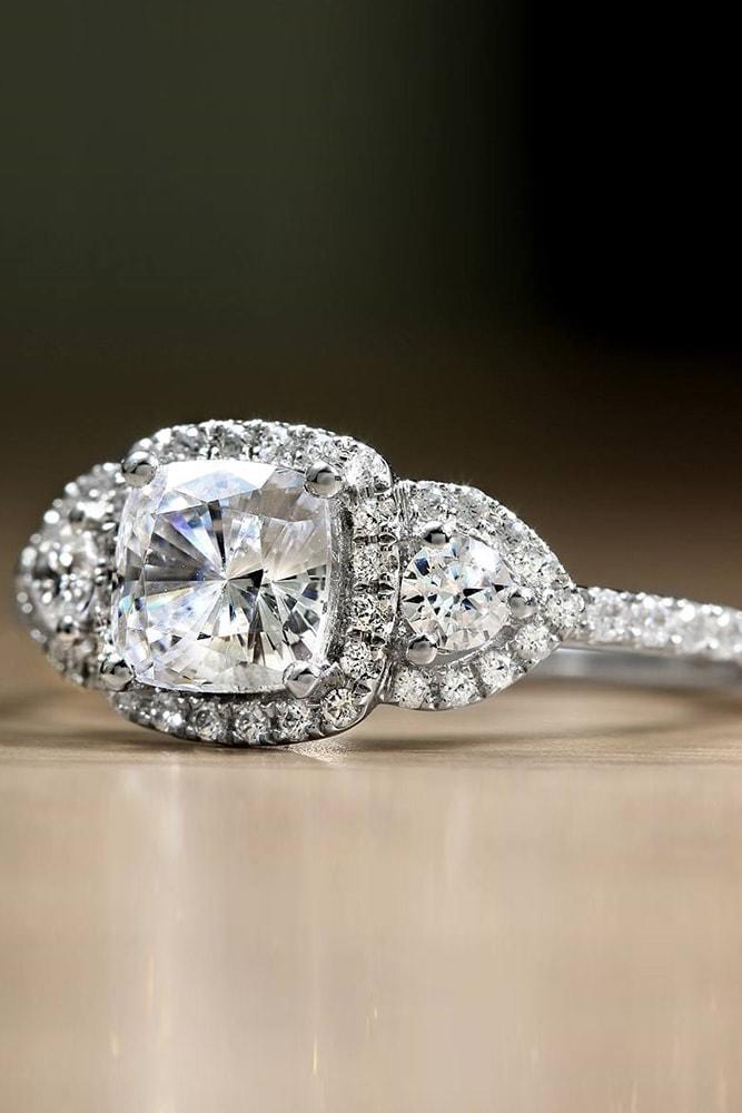 cushion cut engagement rings with diamond halo round cut diamonds on both sides halo three stones pave band