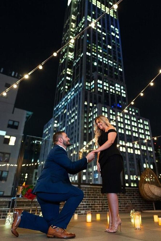 perfect proposals inspired night time roof proposals with lights and candles
