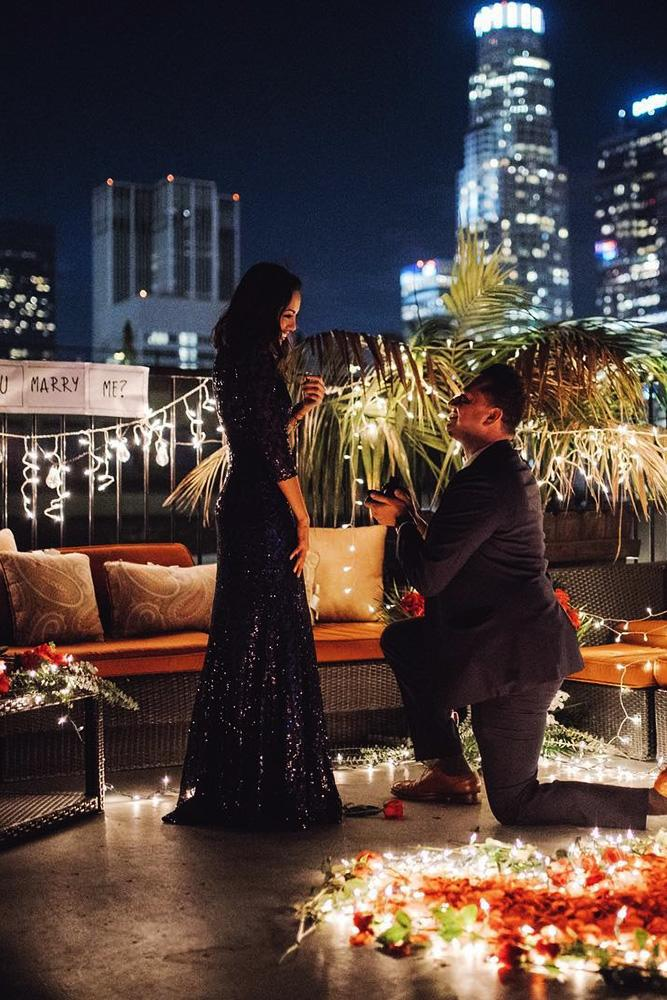perfect proposals inspired night time roof proposals with lights and flowers
