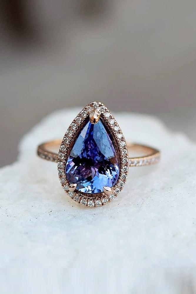 ring trends gemstone engagement rings rose gold pear cut blue sapphire halo