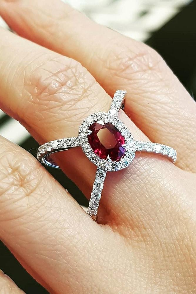 ruby engagement rings white gold oval cut ruby halo split shank modern