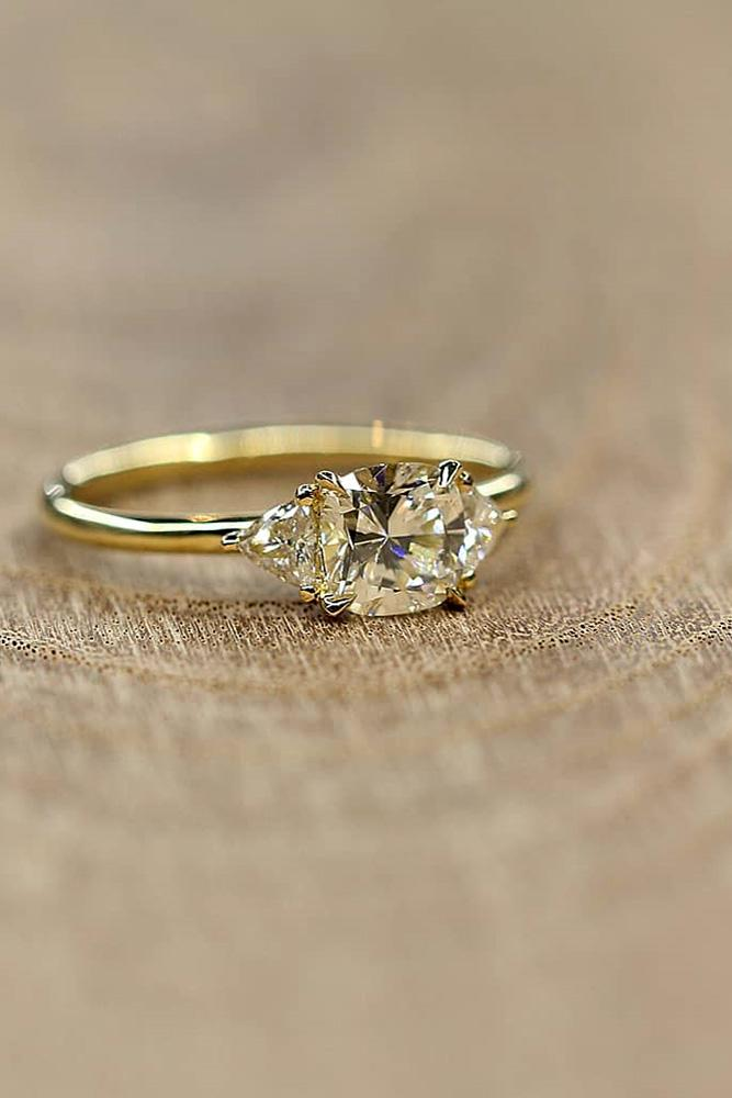 yellow gold engagement rings three stones engagement ring cushion cut diamond in the centre simple pave band