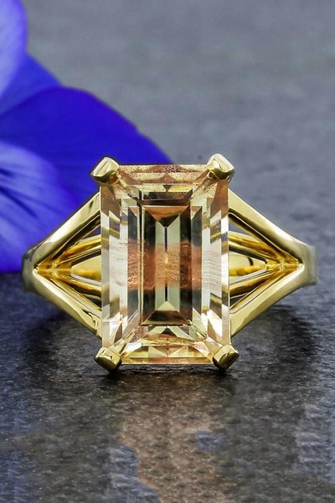 emerald engagement rings yellow gold emerald cut yellow diamond split shank