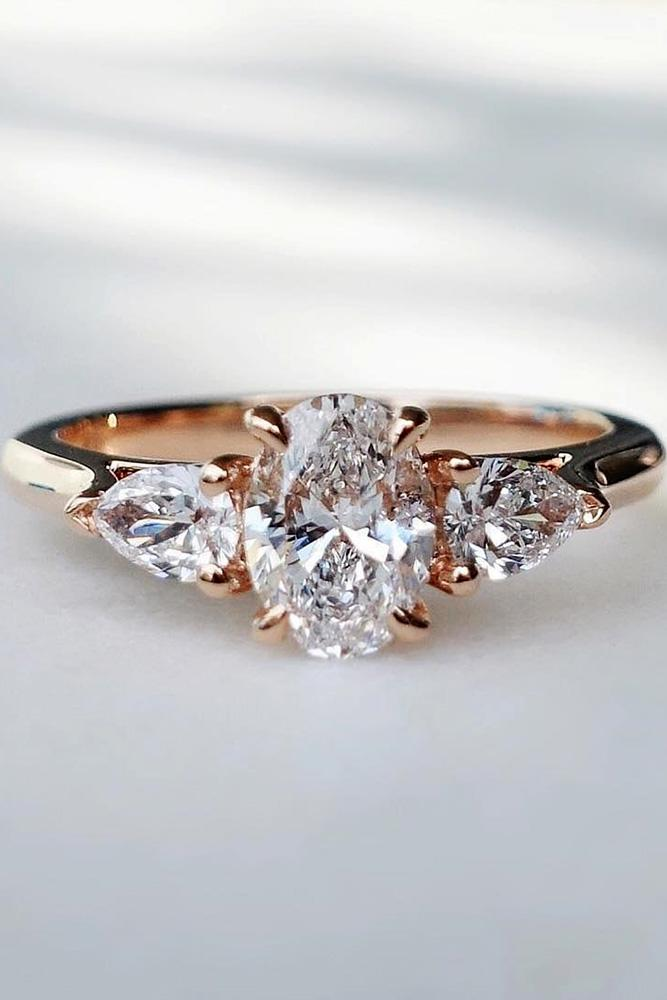 oval cut engagement rings rose gold engagement rings diamond engagement rings three stone engagement diamond rings