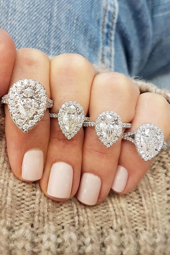white gold engagement rings pear cut engagement rings diamond engagement rings halo engagement rings