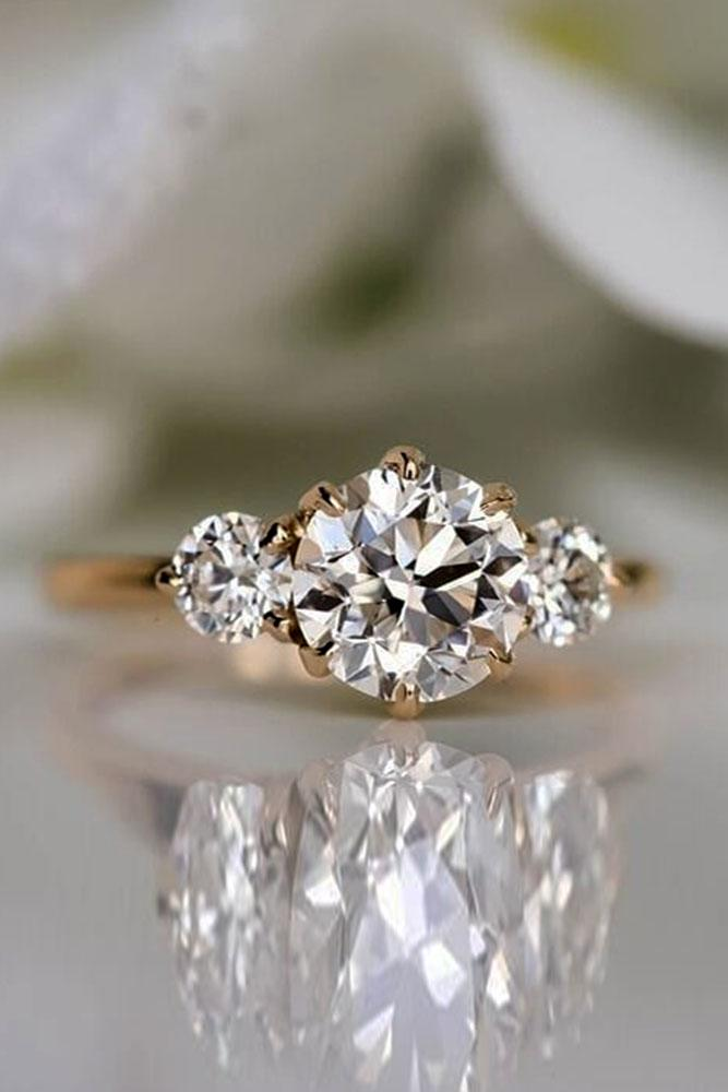 rose gold engagement rings diamond engagement rings three stone engagement rings round cut engagement rings