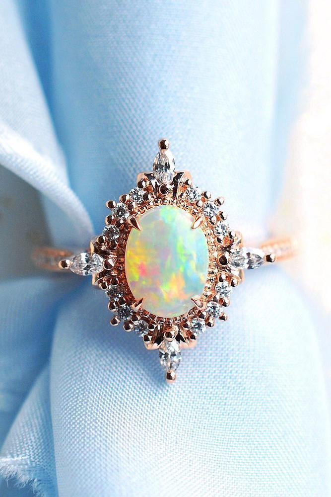 colored engagement rings opal engagement rings rose gold engagement rings oval cut engagement rings