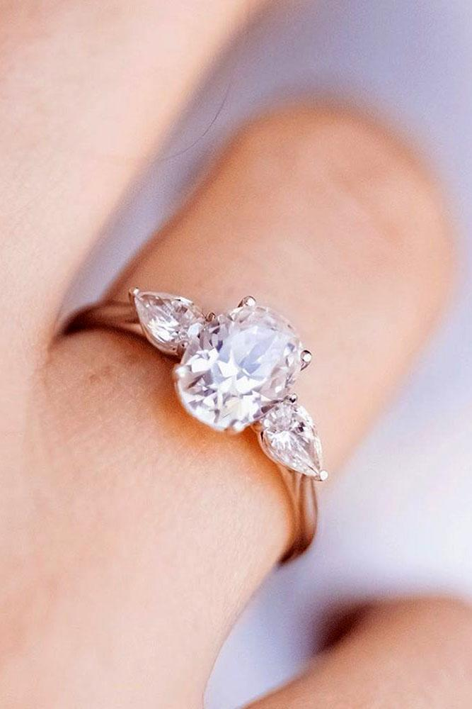 oval engagement rings three stone rings diamond rings pear cut ring