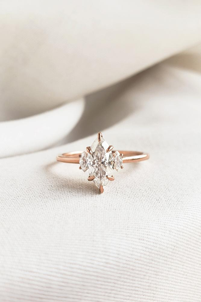 marquise diamond rose gold engagement ring three stone ring moissanite