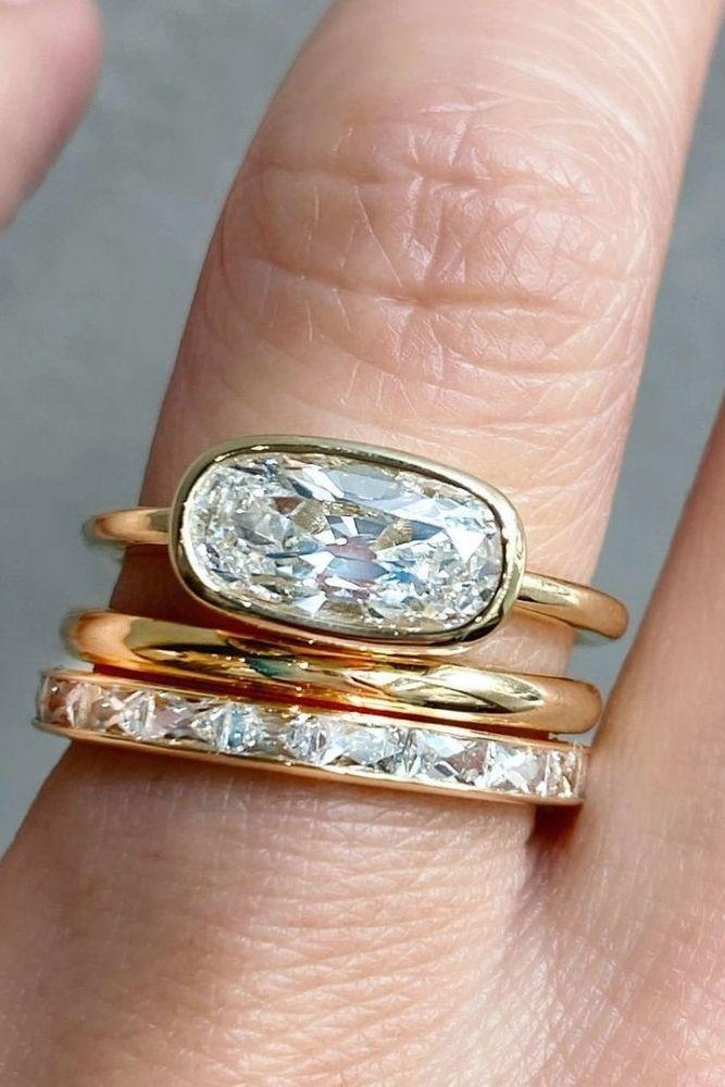 simple engagement rings with oval center stone