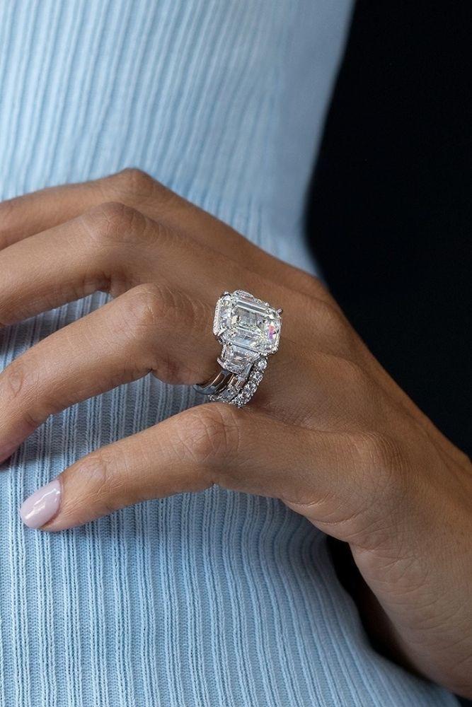diamond wedding rings with emerald cut center stone
