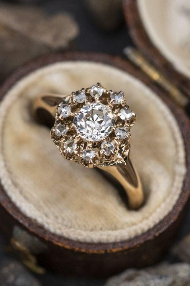 vintage engagement rings with round cut center stone1