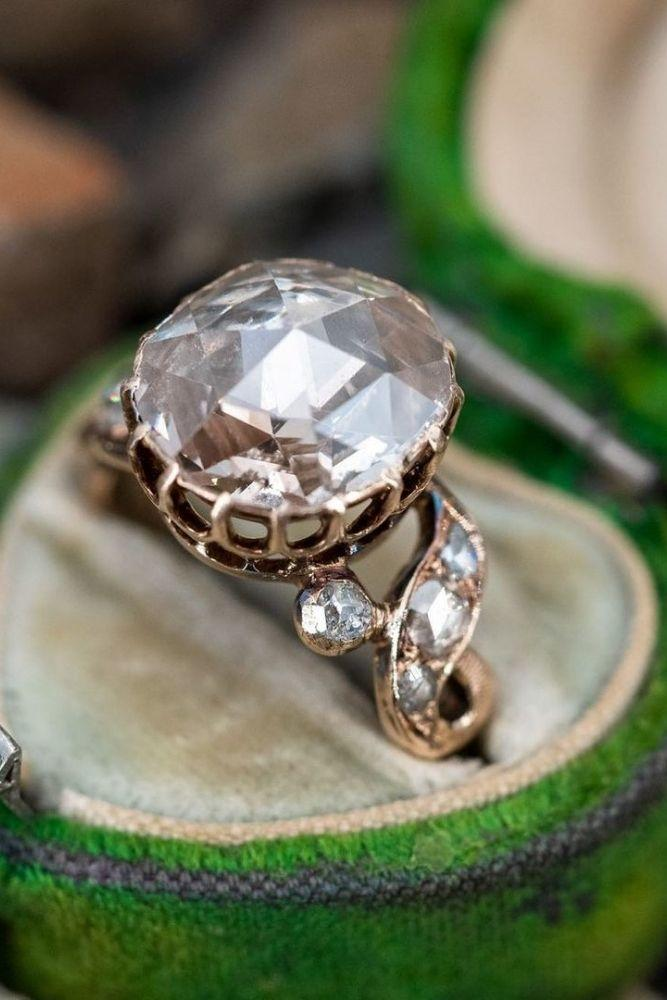 vintage engagement rings with round cut center stone2