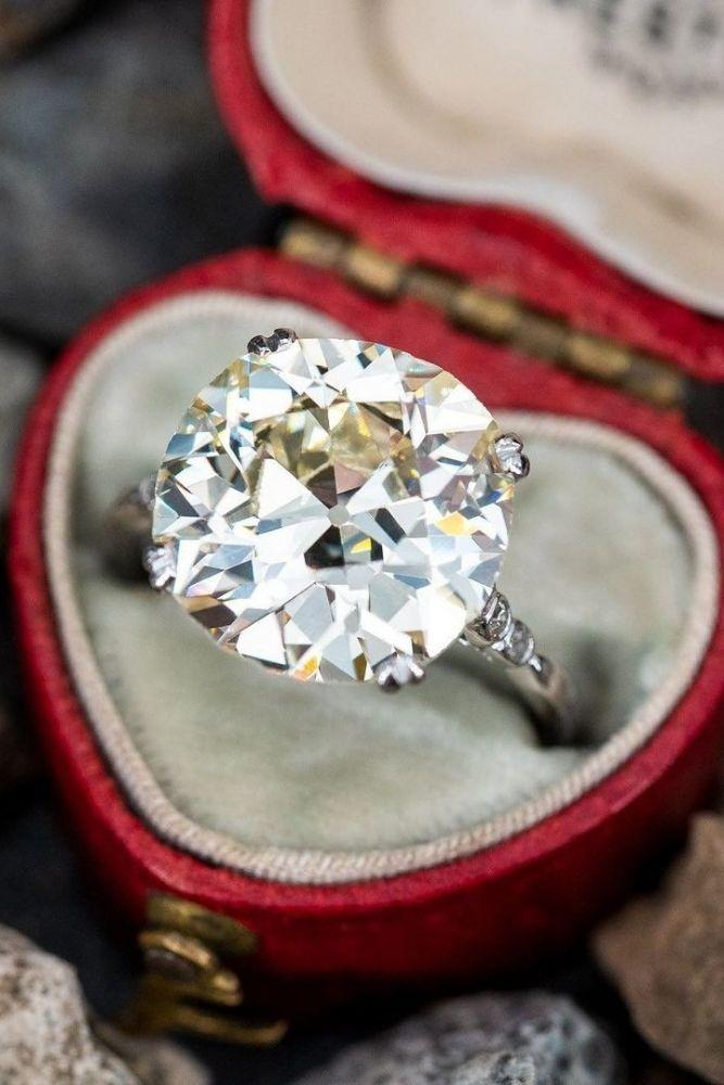 vintage engagement rings with round cut center stone